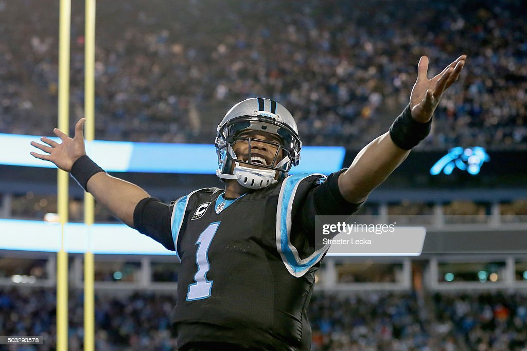 Cam Newton #1 of the Carolina Panthers reacts after a 4th quarter touchdown against the Tampa Bay Buccaneers during their game at Bank of America Stadium on January 3, 2016 in Charlotte, North Carolina.