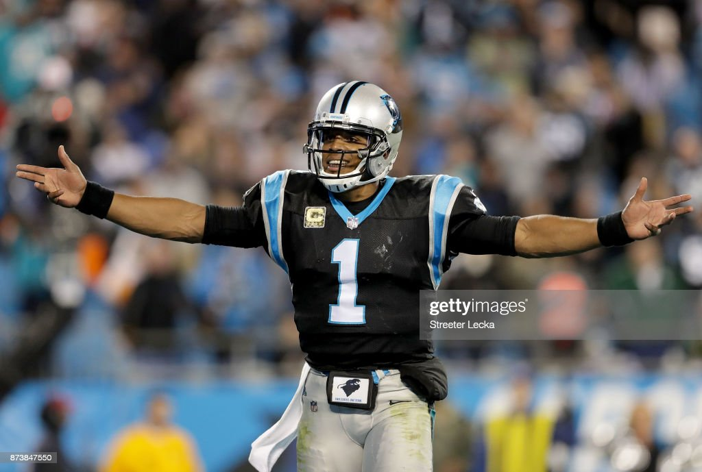 Cam Newton #1 of the Carolina Panthers reacts after a play against the Miami Dolphins during their game at Bank of America Stadium on November 13, 2017 in Charlotte, North Carolina.