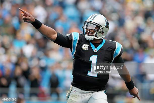 Cam Newton of the Carolina Panthers reacts after a rushing touchdown against the Green Bay Packers in the 2nd quarter during their game at Bank of...