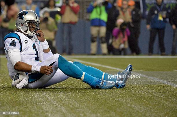 Cam Newton of the Carolina Panthers reacts after a third down loss in the first quarter against the Seattle Seahawks during the 2015 NFC Divisional...
