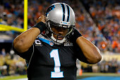 Cam Newton of the Carolina Panthers reacts after being hit in the fourth quarter of Super Bowl 50 against the Denver Broncos at Levi's Stadium on...