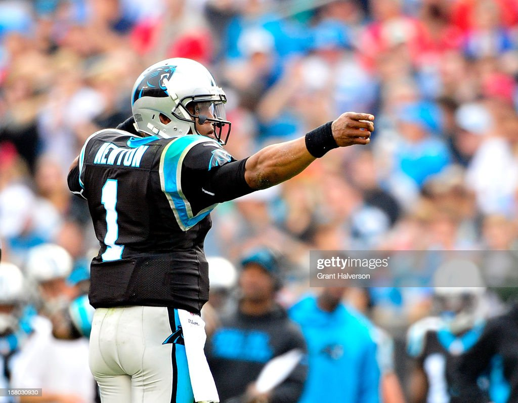 Cam Newton #1 of the Carolina Panthers reacts after running for a first down against the Atlanta Falcons during play at Bank of America Stadium on December 9, 2012 in Charlotte, North Carolina.