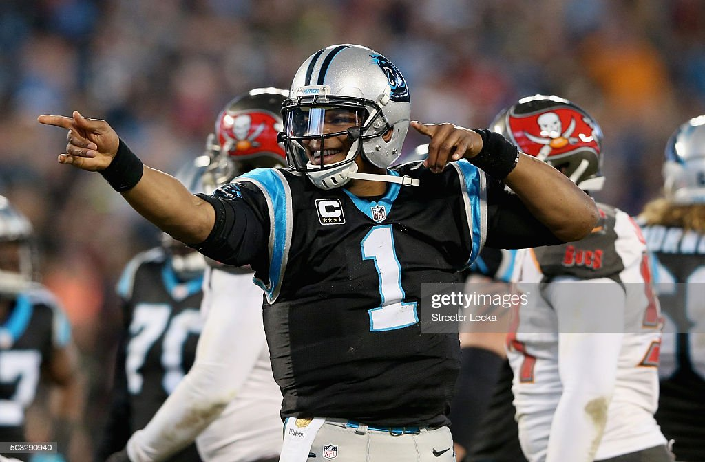 Cam Newton #1 of the Carolina Panthers reacts after running for a first down in the second quarter of their game against the Tampa Bay Buccaneers at Bank of America Stadium on January 3, 2016 in Charlotte, North Carolina.