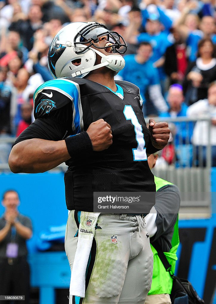Cam Newton #1 of the Carolina Panthers reacts after scoring a touchdown against the Atlanta Falcons during play at Bank of America Stadium on December 9, 2012 in Charlotte, North Carolina. Carolina defeated Atlanta 30-20.