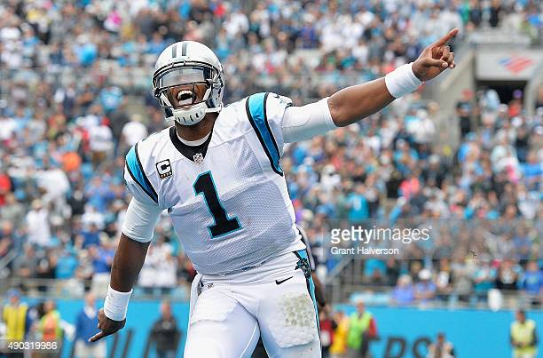 Cam Newton of the Carolina Panthers reacts after throwing for a touchdown against the New Orleans Saints during their game at Bank of America Stadium...