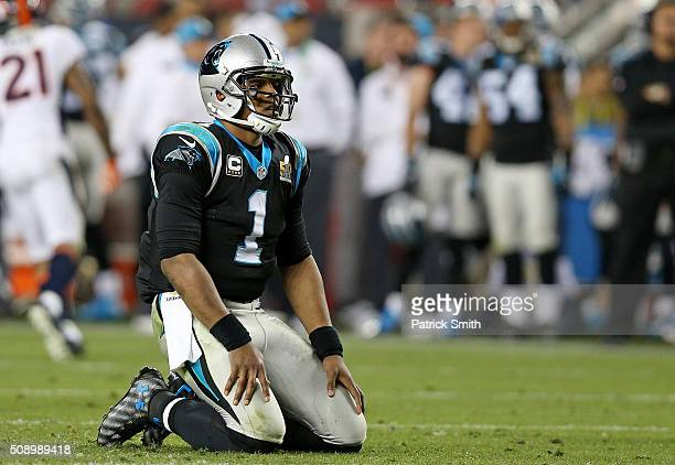 Cam Newton of the Carolina Panthers reacts on his knees after a play in the fourth quarter against the Denver Broncos during Super Bowl 50 at Levi's...