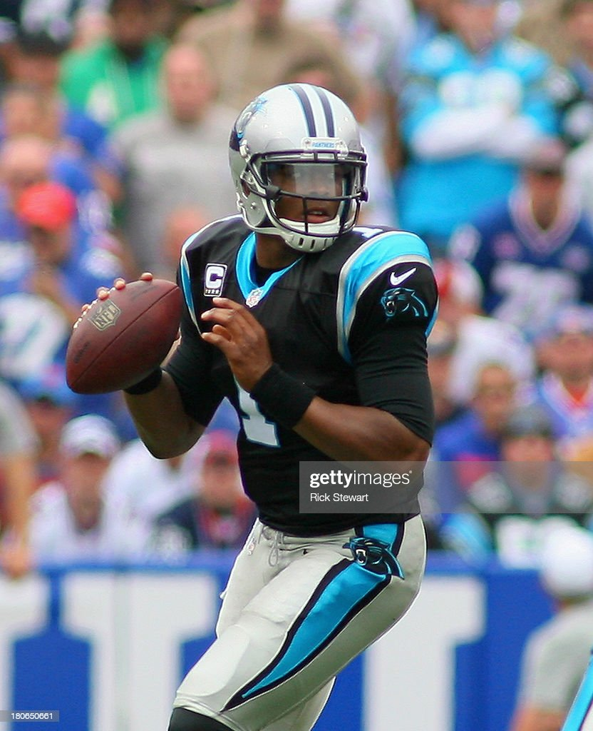 <a gi-track='captionPersonalityLinkClicked' href=/galleries/search?phrase=Cam+Newton+-+American+Football+Quarterback&family=editorial&specificpeople=4516761 ng-click='$event.stopPropagation()'>Cam Newton</a> #1 of the Carolina Panthers readies to pass against the Buffalo Bills at Ralph Wilson Stadium on September 15, 2013 in Orchard Park, New York. Buffalo won 24-23.