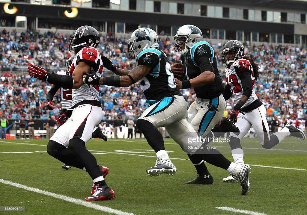 Cam Newton #1 of the Carolina Panthers runs for a touchdown during their game against the Atlanta Falcons at Bank of America Stadium on December 9, 2012 in Charlotte, North Carolina.