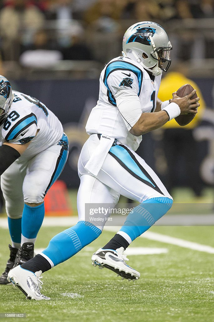 Cam Newton #1 of the Carolina Panthers runs the ball against the New Orleans Saints at Mercedes-Benz Superdome on December 30, 2012 in New Orleans, Louisiana. The Panthers defeated the Saints 44-38.