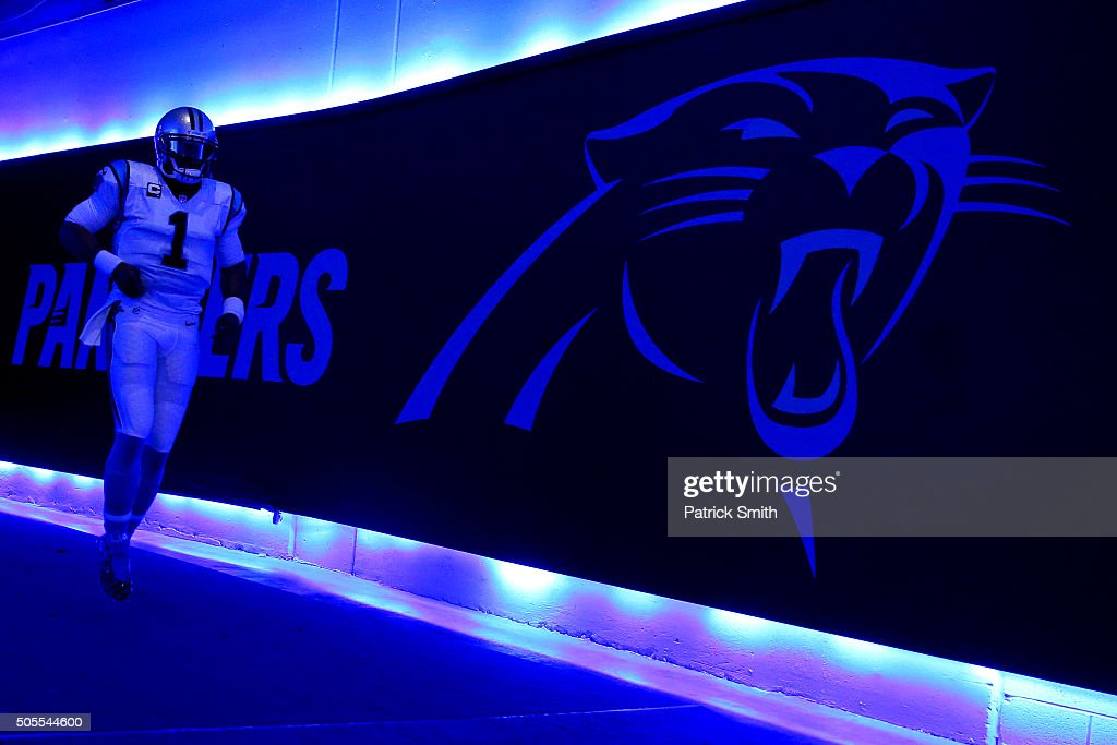 Cam Newton of the Carolina Panthers runs through the tunnel before playing the Seattle Seahawks at the NFC Divisional Playoff Game at Bank of America...