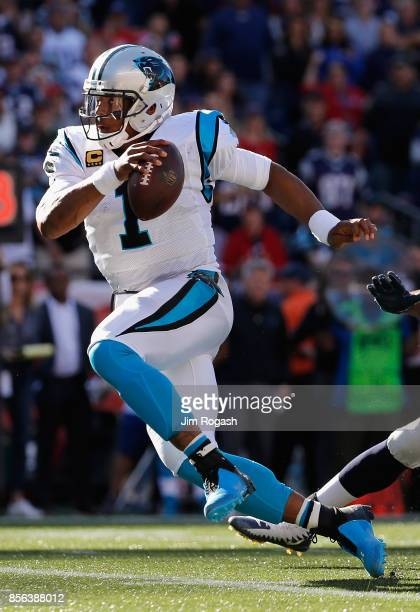 Cam Newton of the Carolina Panthers runs with the ball during the second half against the New England Patriots at Gillette Stadium on October 1 2017...
