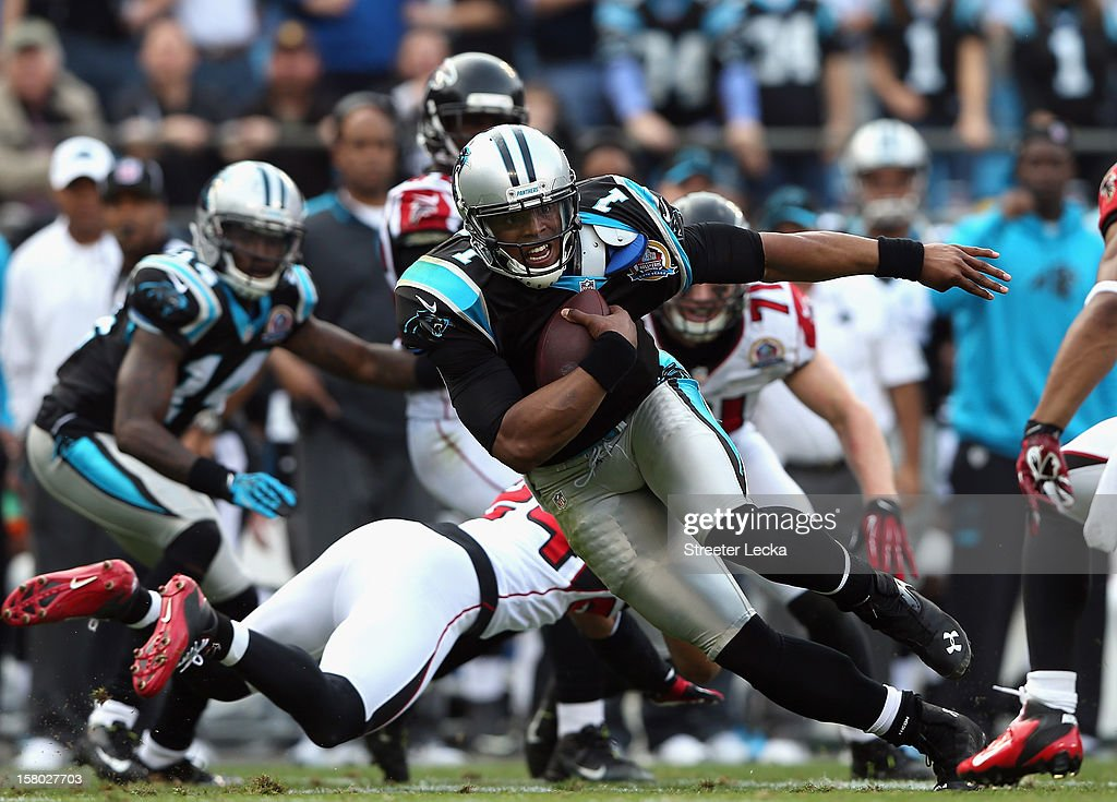 Cam Newton #1 of the Carolina Panthers runs with the ball during their game against the Atlanta Falcons at Bank of America Stadium on December 9, 2012 in Charlotte, North Carolina.