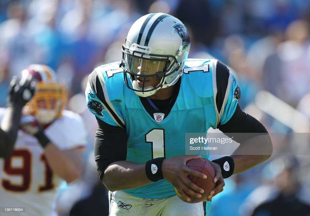 <a gi-track='captionPersonalityLinkClicked' href=/galleries/search?phrase=Cam+Newton+-+American+Football+Quarterback&family=editorial&specificpeople=4516761 ng-click='$event.stopPropagation()'>Cam Newton</a> #1 of the Carolina Panthers rushes for a second half touchdown during their game against the Washington Redskins at Bank of America Stadium on October 23, 2011 in Charlotte, North Carolina.
