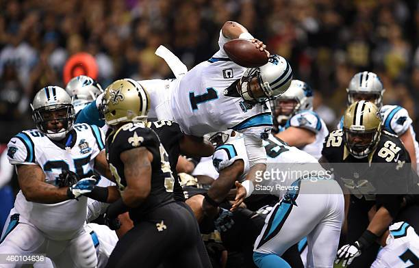 Cam Newton of the Carolina Panthers scores a touchdown during the first quarter against the New Orleans Saints at MercedesBenz Superdome on December...