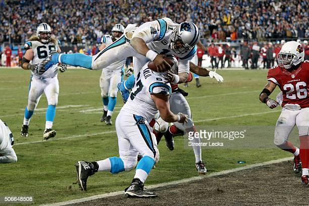 Cam Newton of the Carolina Panthers scores a touchdown in the third quarter against the Arizona Cardinals during the NFC Championship Game at Bank of...