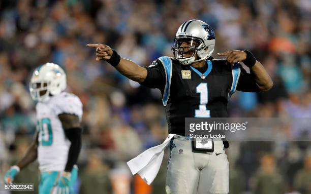 Cam Newton of the Carolina Panthers signals a first down against the Miami Dolphins in the first quarter during their game at Bank of America Stadium...
