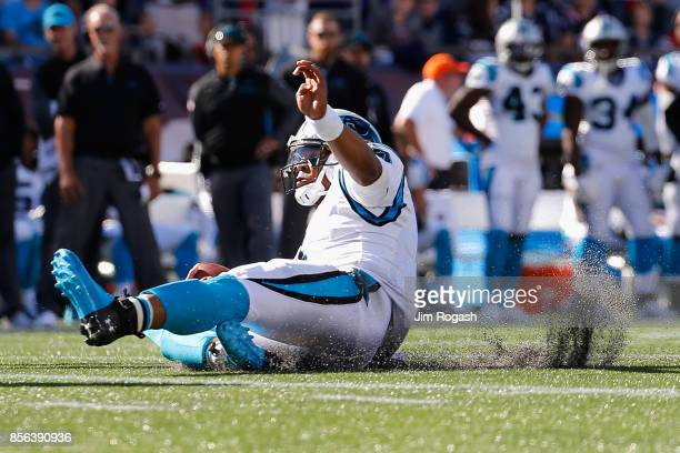 Cam Newton of the Carolina Panthers slides during the second half against the New England Patriots at Gillette Stadium on October 1 2017 in Foxboro...