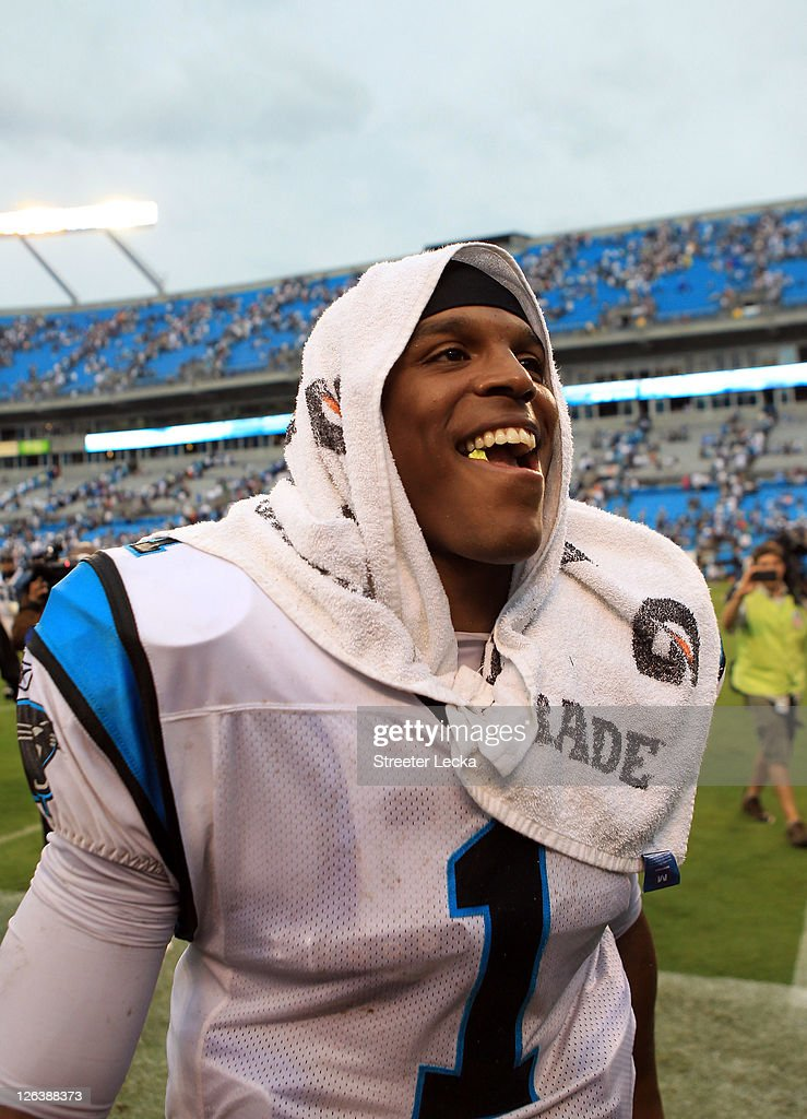 <a gi-track='captionPersonalityLinkClicked' href=/galleries/search?phrase=Cam+Newton+-+American+Football+Quarterback&family=editorial&specificpeople=4516761 ng-click='$event.stopPropagation()'>Cam Newton</a> #1 of the Carolina Panthers smiles as he walks off the field after defeating the Jacksonville Jaguars 16-10 at Bank of America Stadium on September 25, 2011 in Charlotte, North Carolina.