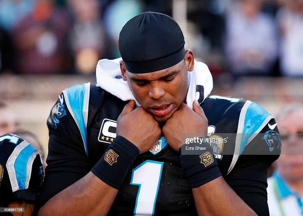 Cam Newton #1 of the Carolina Panthers stands on the sideline during the National Anthem prior to playing the Denver Broncos in Super Bowl 50 at Levi's Stadium on February 7, 2016 in Santa Clara, California.