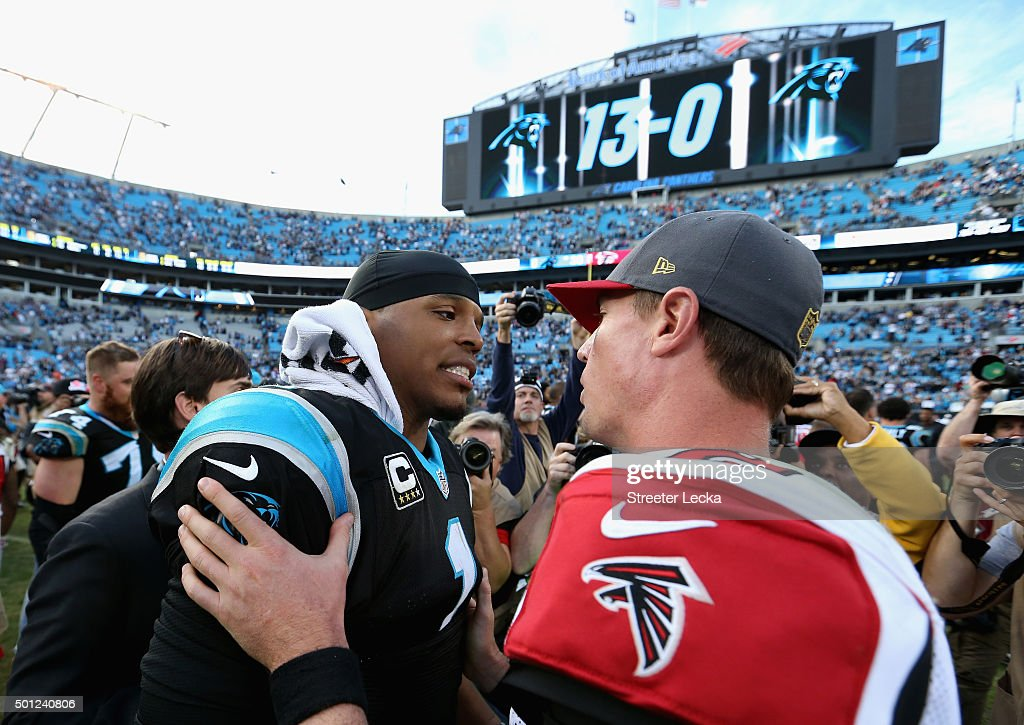 Cam Newton #1 of the Carolina Panthers talks to Matt Ryan #2 of the Atlanta Falcons after defeating the Atlanta Falcons 38-0 at Bank of America Stadium on December 13, 2015 in Charlotte, North Carolina.