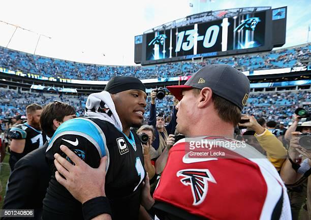 Cam Newton of the Carolina Panthers talks to Matt Ryan of the Atlanta Falcons after defeating the Atlanta Falcons 380 at Bank of America Stadium on...