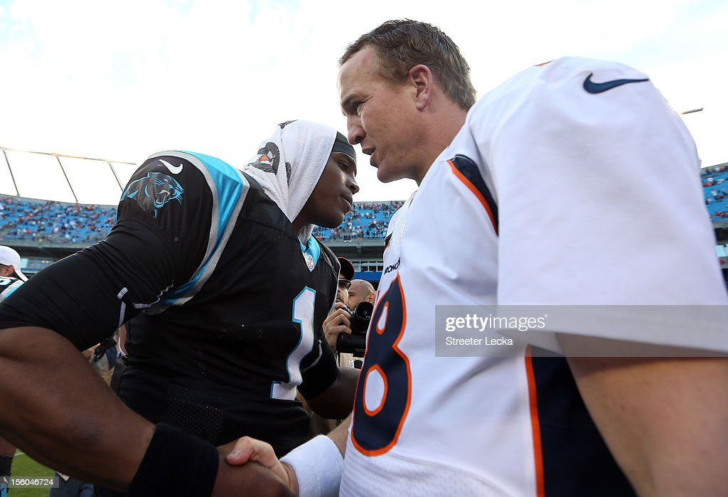 Cam Newton #1 of the Carolina Panthers talks to <a gi-track='captionPersonalityLinkClicked' href=/galleries/search?phrase=Peyton+Manning&family=editorial&specificpeople=184524 ng-click='$event.stopPropagation()'>Peyton Manning</a> #18 of the Denver Broncos after their game at Bank of America Stadium on November 11, 2012 in Charlotte, North Carolina.
