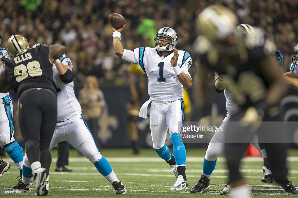Cam Newton #1 of the Carolina Panthers throws a pass against the New Orleans Saints at Mercedes-Benz Superdome on December 30, 2012 in New Orleans, Louisiana. The Panthers defeated the Saints 44-38.