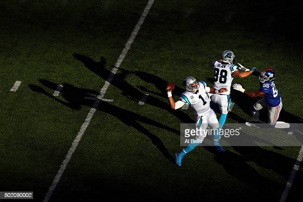 Cam Newton of the Carolina Panthers throws a pass in the first quarter against the New York Giants during their game at MetLife Stadium on December...