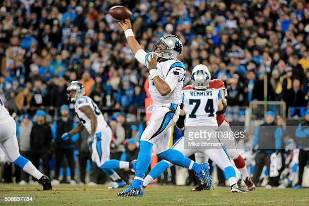 Cam Newton of the Carolina Panthers throws a pass in the first quarter against the Arizona Cardinals during the NFC Championship Game at Bank of...
