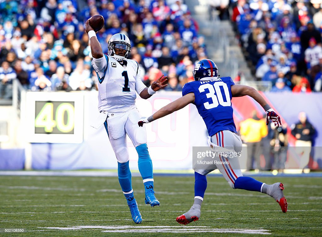 Cam Newton #1 of the Carolina Panthers throws a pass in the second quarter against Cooper Taylor #30 of the New York Giants during their game at MetLife Stadium on December 20, 2015 in East Rutherford, New Jersey.