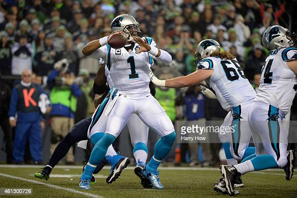 Cam Newton of the Carolina Panthers throws the ball in the first quarter against the Seattle Seahawks during the 2015 NFC Divisional Playoff game at...
