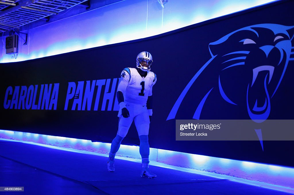Cam Newton #1 of the Carolina Panthers walks out to the field prior to their game against the Miami Dolphins during their game at Bank of America Stadium on August 22, 2015 in Charlotte, North Carolina.