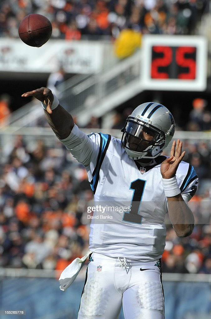 Cam Newton #1 of the Carolina Panthers warms up during an injury timeout against the Chicago Bears on October 28, 2012 at Soldier Field in Chicago, Illinois.
