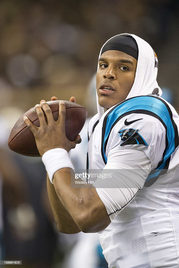 Cam Newton #1 of the Carolina Panthers warms up on the sidelines during a game against the New Orleans Saints at Mercedes-Benz Superdome on December 30, 2012 in New Orleans, Louisiana. The Panthers defeated the Saints 44-38.