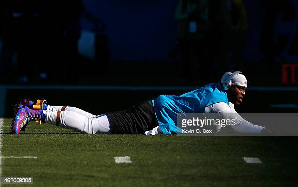 Cam Newton of the Carolina Panthers warms up prior to the NFC Divisional Playoff Game against the San Francisco 49ers at Bank of America Stadium on...
