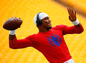 Cam Newton of the Carolina Panthers warms up prior to the preseason game against the Pittsburgh Steelers at Heinz Field on September 3 2015 in...