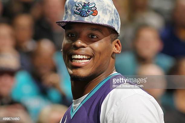 Cam Newton quarterback of the Carolina Panthers attends the Charlotte Hornets against the Golden State Warriors game on December 2 2015 at Time...