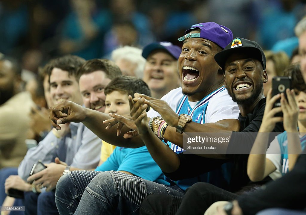 <a gi-track='captionPersonalityLinkClicked' href=/galleries/search?phrase=Cam+Newton+-+American+Football+Quarterback&family=editorial&specificpeople=4516761 ng-click='$event.stopPropagation()'>Cam Newton</a>, quarterback of the Carolina Panthers, reacts as he watches the game between the Cleveland Cavaliers and Charlotte Hornets at Time Warner Cable Arena on November 27, 2015 in Charlotte, North Carolina. NBA -