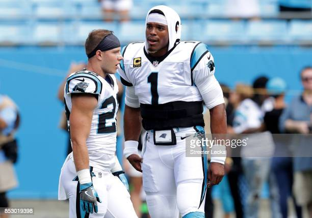 Cam Newton talks to teammate Christian McCaffrey of the Carolina Panthers before their game against the New Orleans Saints at Bank of America Stadium...