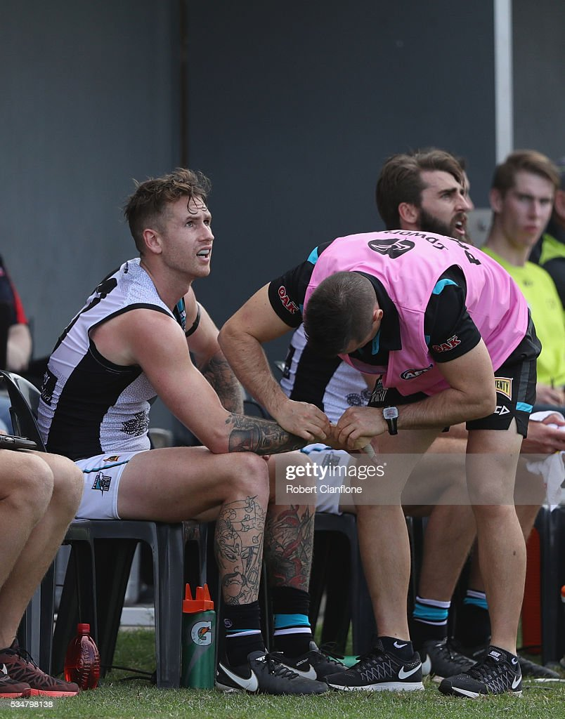 Cam O'Shea of Port Adelaide is treated on the bench during the round 10 AFL match between the Melbourne Demons and the Port Adelaide Power at Traeger Park on May 28, 2016 in Alice Springs, Australia.