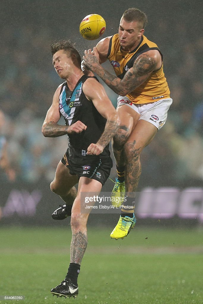 Cam O'Shea of the Power clashes with Dustin Martin of the Tigers during the 2016 AFL Round 15 match between Port Adelaide Power and the Richmond Tigers at Adelaide Oval on July 1, 2016 in Adelaide, Australia.