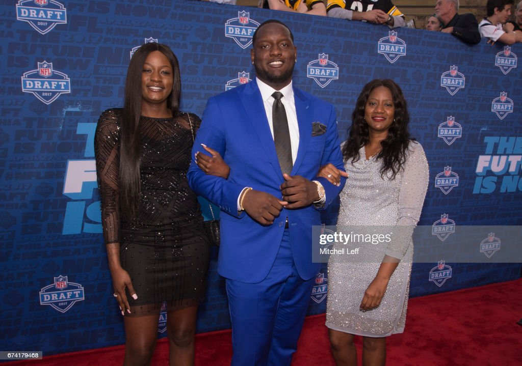 Cam Robinson of Alabama poses for a picture with his sister Charity Robinson and mother Priscillia Robinson on the red carpet prior to the start of the 2017 NFL Draft on April 27, 2017 in Philadelphia, Pennsylvania.