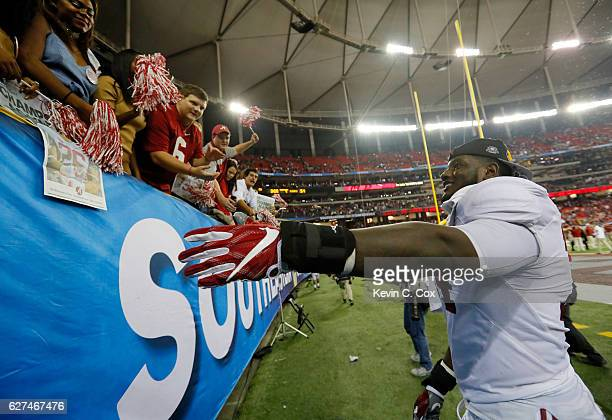 Cam Robinson of the Alabama Crimson Tide celebrates their 54 to 16 win over the Florida Gators in the SEC Championship game at the Georgia Dome on...
