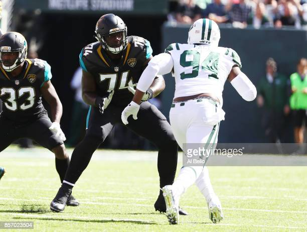 Cam Robinson of the Jacksonville Jaguars in action against Kony Ealy of the New York Jets during their game at MetLife Stadium on October 1 2017 in...