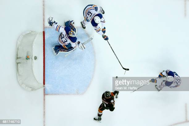 Cam Talbot Adam Larsson and Drake Caggiula of the Edmonton Oilers defend against Andrew Cogliano of the Anaheim Ducks during the first period in Game...