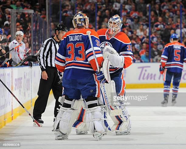 Cam Talbot and Anders Nilsson of the Edmonton Oilers trade places in net during a game against the Washington Capitals on October 23 2015 at Rexall...