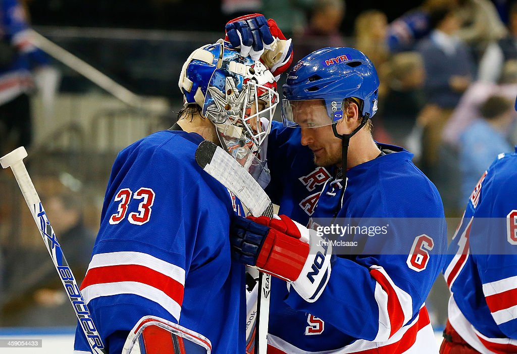 <a gi-track='captionPersonalityLinkClicked' href=/galleries/search?phrase=Cam+Talbot&family=editorial&specificpeople=7185126 ng-click='$event.stopPropagation()'>Cam Talbot</a> #33 and <a gi-track='captionPersonalityLinkClicked' href=/galleries/search?phrase=Anton+Stralman&family=editorial&specificpeople=2271901 ng-click='$event.stopPropagation()'>Anton Stralman</a> #6 of the New York Rangers celebrate after defeating the Minnesota Wild at Madison Square Garden on December 22, 2013 in New York City.