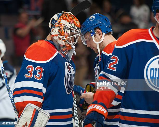 Cam Talbot and Leon Draisaitl of the Edmonton Oilers celebrate after winning the game against the Winnipeg Jets on September 23 2015 at Rexall Place...