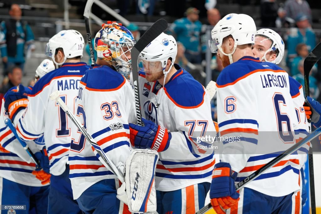 Cam Talbot #33 and Oscar Klefbom #77 react after the Oilers win the game against the San Jose Sharks in Game Six of the Western Conference First Round during the 2017 NHL Stanley Cup Playoffs at SAP Center at San Jose on April 22, 2017 in San Jose, California. The Oilers defeated the Sharks 3-1.