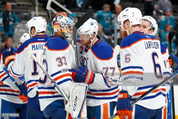 Cam Talbot and Oscar Klefbom react after the Oilers win the game against the San Jose Sharks in Game Six of the Western Conference First Round during...